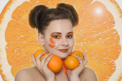Beautiful girl with oranges Royalty Free Stock Photos