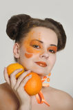 Beautiful girl with oranges Stock Images