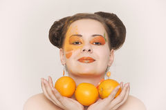 Beautiful girl with oranges Stock Photography