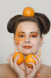 Beautiful girl with oranges Stock Photo