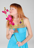 Beautiful girl with an orchid Royalty Free Stock Image