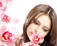 Beautiful girl with orchid Stock Photo