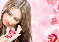 Beautiful girl with orchid Stock Photography