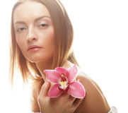 Beautiful girl with orchid flower. Stock Image
