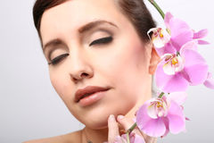 Beautiful Girl With Orchid Flowers. Royalty Free Stock Photography