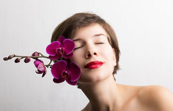 Beautiful girl with orchid flowers Royalty Free Stock Images
