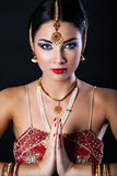Beautiful girl with oriental makeup and Indian Jewelry Stock Images