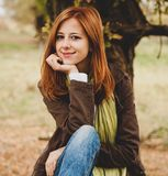 Beautiful girl at outdoor in autumn time royalty free stock photo