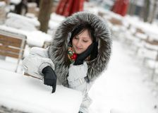 Beautiful girl in an outdoor cafe on a winter day Royalty Free Stock Images