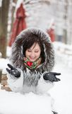 Beautiful girl in an outdoor cafe on a winter day Stock Photos