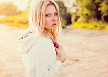 Beautiful girl outdoor in the park looking at you Royalty Free Stock Photo