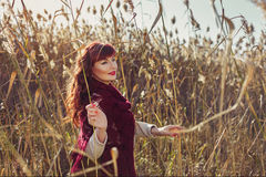 Beautiful girl outdoors in countryside Stock Photos