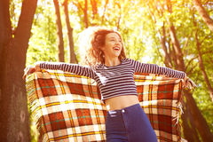 Beautiful Girl Outdoors enjoying nature in forest. royalty free stock photo