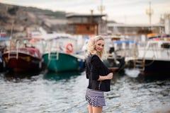 Beautiful girl outdoors. Spring day. The girl near boats on a marina stock photo