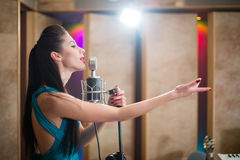 Beautiful girl with outstretched hand sing in room Stock Image