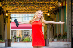 Beautiful girl with outstretched hands in a red dress Royalty Free Stock Photo