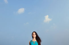 Beautiful girl over blue sky Royalty Free Stock Images