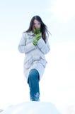 Beautiful girl over blue winter sky and sun Stock Photos