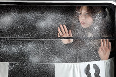Beautiful girl over the snow covered window Royalty Free Stock Photo