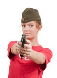 Beautiful girl in overseas cap holding gun. Royalty Free Stock Photos