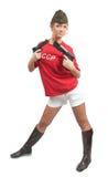 Beautiful girl in overseas cap holding guns Royalty Free Stock Image
