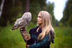 Beautiful girl with an owl Stock Photography
