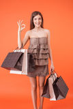 Beautiful girl with packages is expressing Royalty Free Stock Photography
