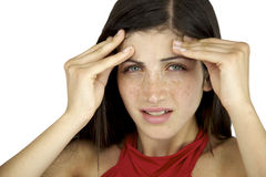 Beautiful girl in pain. Beautiful female model with freckles and blue eyes suffering headache Stock Photos