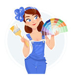 Beautiful girl with paint brush and color swatches Royalty Free Stock Images