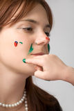 Beautiful girl with paint on face Royalty Free Stock Photos