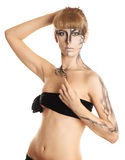 Beautiful girl with a paint on her skin. Blond royalty free stock photo