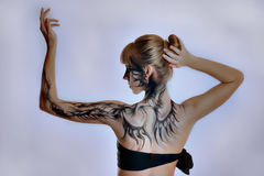 Beautiful girl with a paint on her skin. Blond stock photos