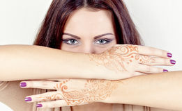 Beautiful girl painted Mehandi. Girl with hands painted Mehandi. Picture by a henna Royalty Free Stock Photo