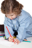 Beautiful girl painting with preschool uniform Stock Photography