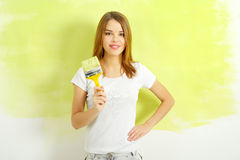 Beautiful girl painting a wall Stock Photos