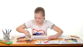 Beautiful girl paints color a stripes paper on stock video footage