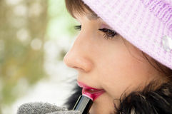 Beautiful girl paints her lips Royalty Free Stock Photography