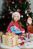 Beautiful girl in pajamas with blue skate is waiting Christmas and New year Stock Images