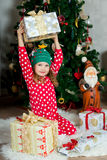 Beautiful girl in pajamas  with gift box is waiting Christmas and New year Royalty Free Stock Photo