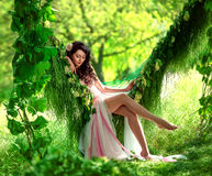Beautiful girl in pale pink dress royalty free stock photography
