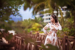 Beautiful girl in palm leaves Stock Images