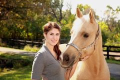 Beautiful Girl with Palomino Horse. Portrait of a teenage girl with her horse Stock Images