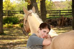 Beautiful Girl with Palomino Horse Royalty Free Stock Images