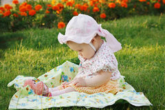 Beautiful girl in panama sitting on flowers meadow Stock Images