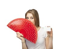 Beautiful girl with a paper fan. On white background beautiful girl with a paper fan Stock Photos