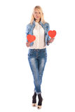 Beautiful girl with paper hearts posing Stock Images