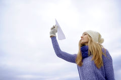 Beautiful girl and paper plane royalty free stock photo