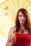 Beautiful girl with parasol in red dress. Beautiful girl with yellow parasol in a red dress royalty free stock images