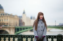 Beautiful girl in Paris, on a bridge Royalty Free Stock Image