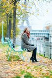 Beautiful girl in Paris on a fall day Stock Photography